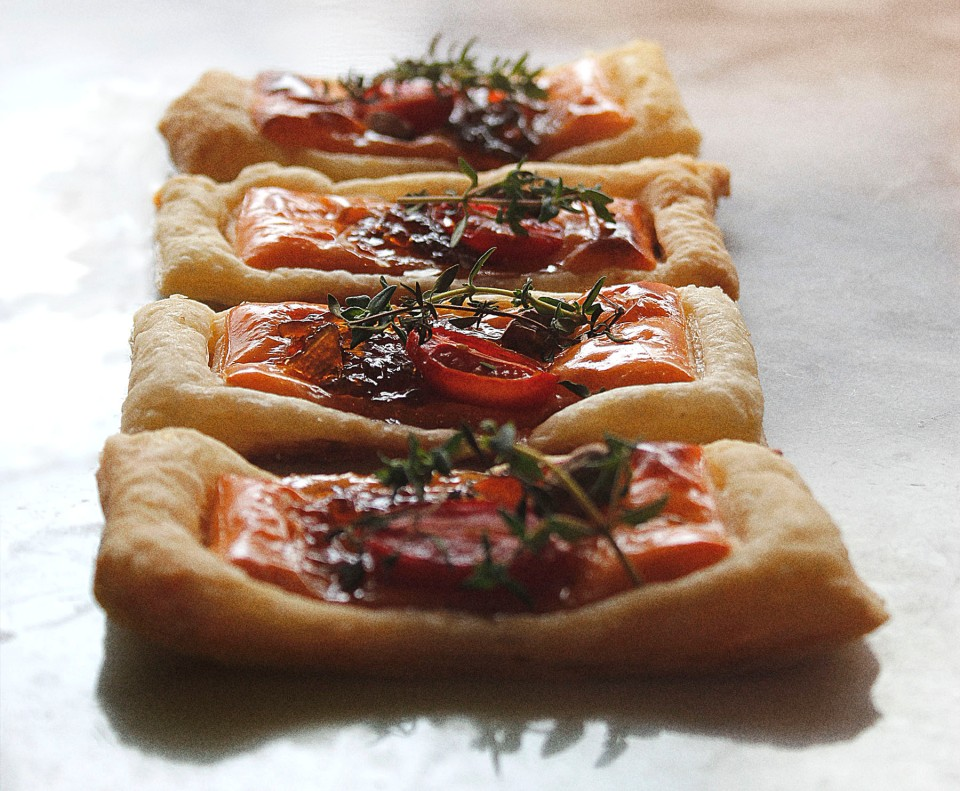 Puff pastry topped with mature cheddar, rosa tomatoes, pistachio nuts, onion marmalade and thyme.